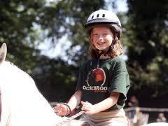 girl riding white horse