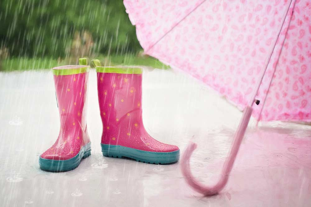 pink rain boots and umbrella
